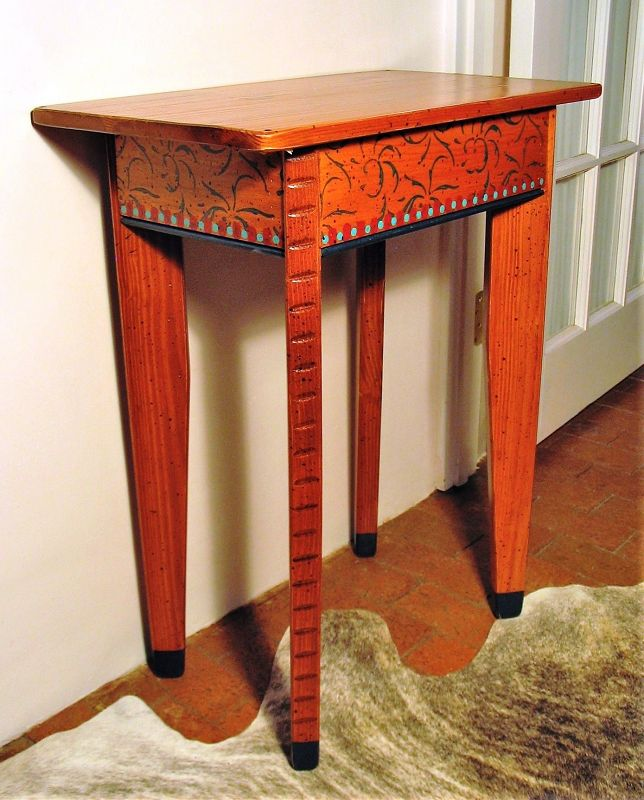 "DESCRIPTION: Finely hand crafted small console table, perfect for an end table, bedside table, a printer, or anywhere you need a little extra surface space. Painted with green vine stencils and alternating red and light blue dots. Like new condition. DIMENSIONS: 30"" high x 24"" wide x 13.75"" deep.